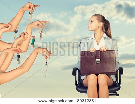 Businesswoman sitting profile in the chair