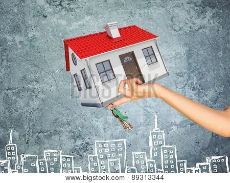 House and bunch of key on businesswomans hand