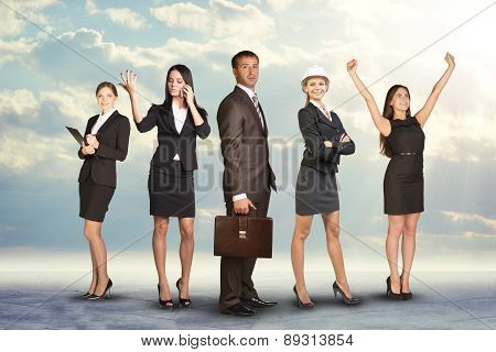 Business people with leader profile on foreground