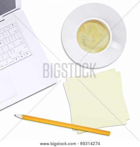 White laptop and cup of coffee on plate, top view