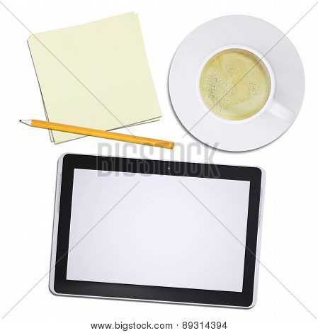 Black tablet and coffee cup on plate, top view
