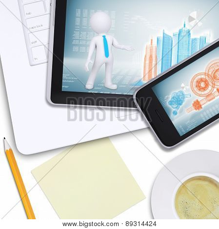 Tablet and mobile on laptop with note paper