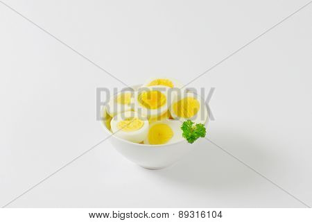 halved hard boiled eggs in the bowl