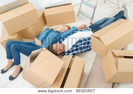 Couple tired from moving house