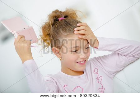 Girl with a hand held games console