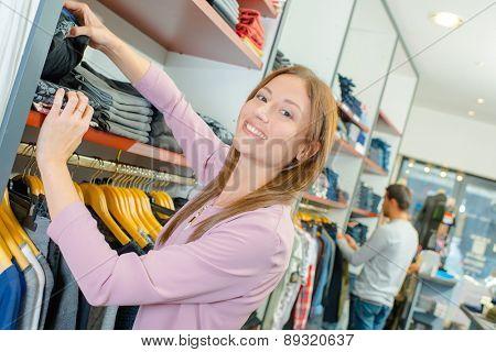 Shop assistant stacking shelves