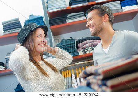 Couple shopping for hats