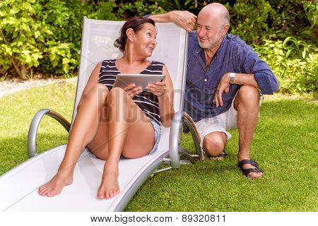 tablet reading seniors in garden explaining