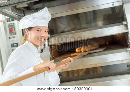 Placing bread in the oven