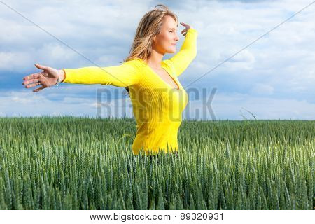female standing green corn field cloudy day
