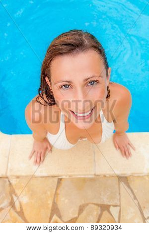 smilling female while leaving pool