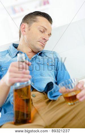 Drunk man on a sofa