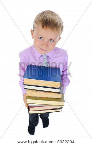 Boy Holds A Stack Of Books