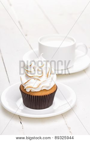 Cupcakes With White Cream With Cup
