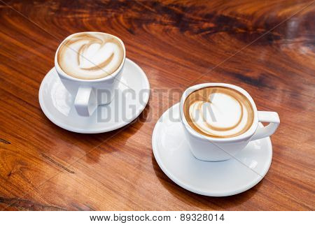 A Cup of coffee latte on wood table