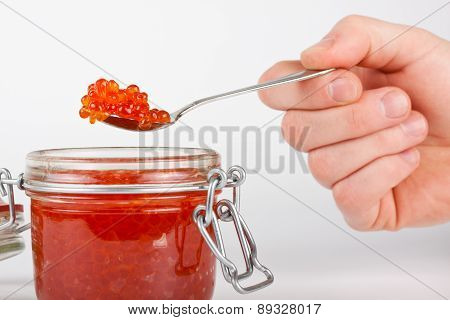 Red caviar in the jar
