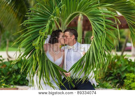 young loving couple on tropical sea background - wedding on beach