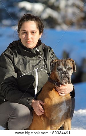 Young Woman With Boxer Dog