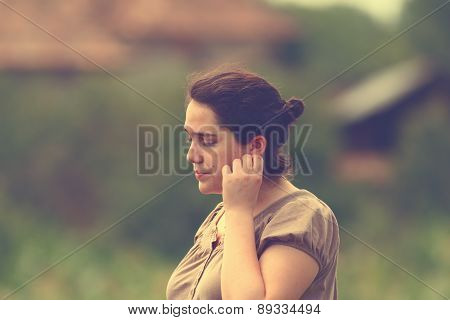 Pensive Woman Outdoor Portrait