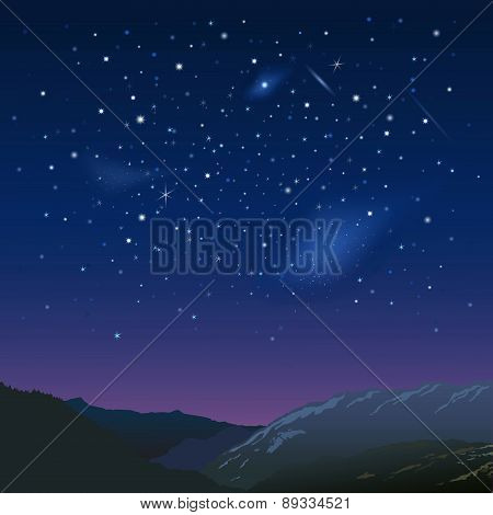 Night starry sky over the mountains
