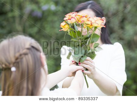 Girl Giving Flowers For Mothers Day