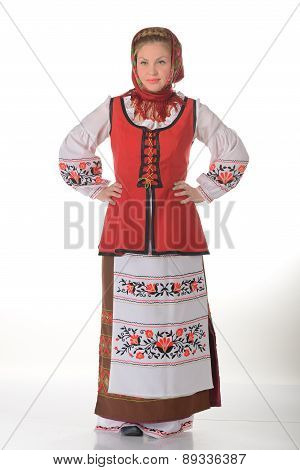 Young blonde woman dressd in traditional folk costume