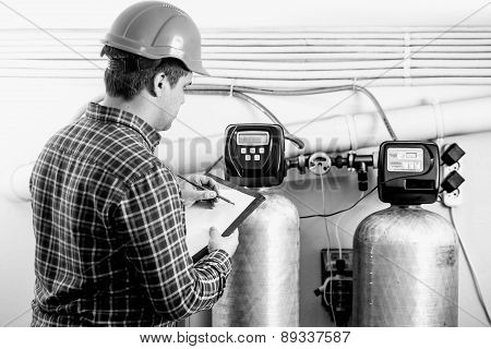 Black And White Shot Of Inspector Checking Factory Equipment