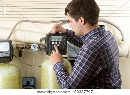 Engineer Checking Pressure Meters At Factory