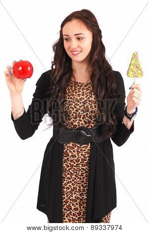 Teen Girl With One Lollipop And One Apple