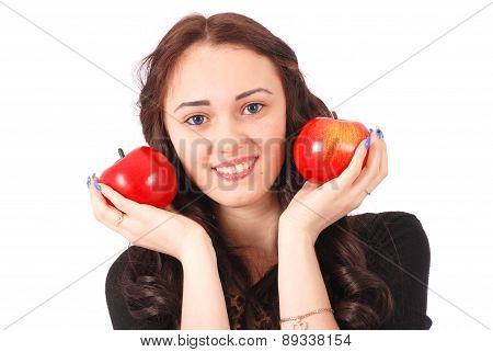 Teen Girl Holds Near The Face Apples