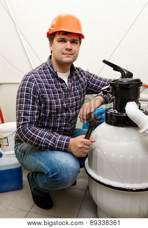 Plumber Posing At New Pumping System With Tools