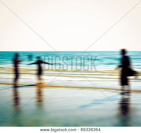 Blur Defocused Of Beach Lifestyle With  Silhouette Of People