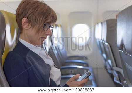 Checking Smart Phone In The Airplane
