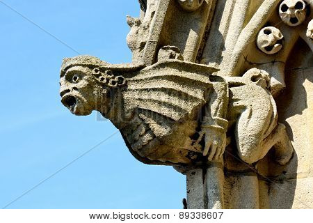 Stone gargoyle on church spire