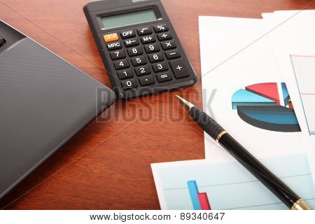 Calculator, Laptop And Financial Documents