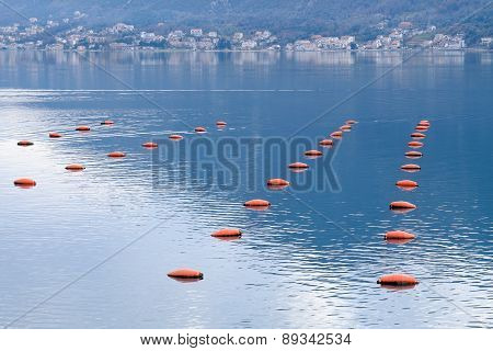 Red Buoys In The Sea