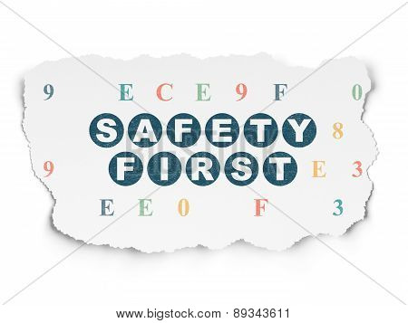 Security concept: Safety First on Torn Paper background