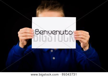 Child Holding Sign With Italian Word Benvenuto - Welcome