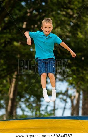 Boy At Trampoline