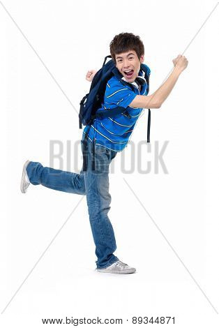 Full length casual young man in jeans standing fun gesture