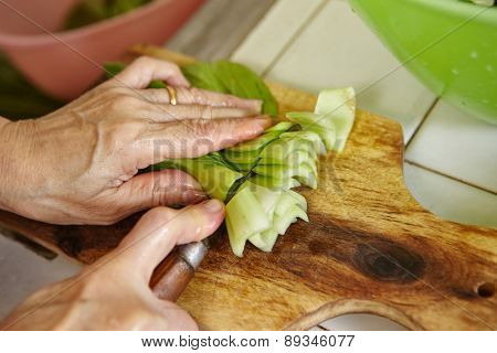 Cutting bok choy / Chinese cabbage on the cutting board