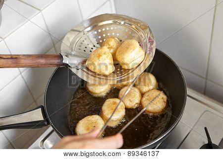 Frying fish cake in the kitchen
