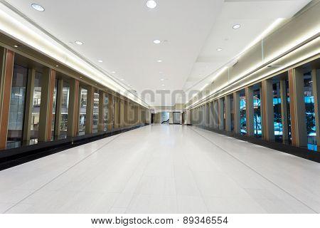 Empty corridor in modern commercial building
