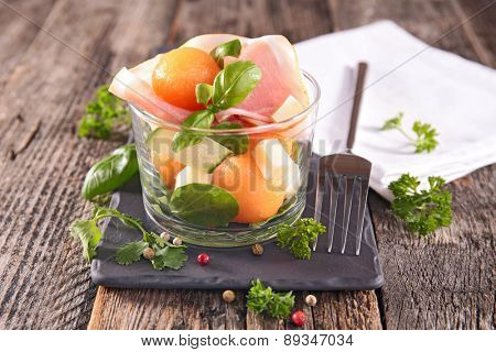 salad with melon,cucumber and prosciutto
