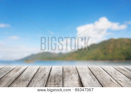 Wood Planks Floor With Blurry Scenic Landscape
