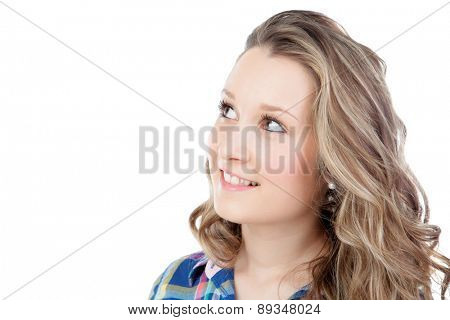 Casual blonde girl looking up isolated on a white background