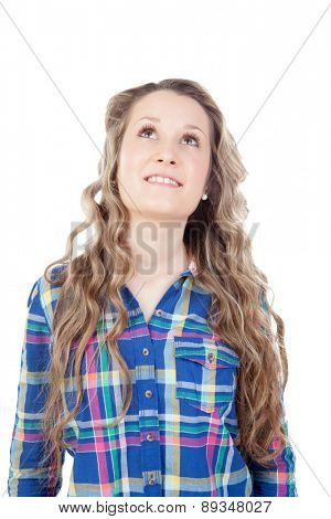 Casual girl with blue shirt looking up isolated on a white background