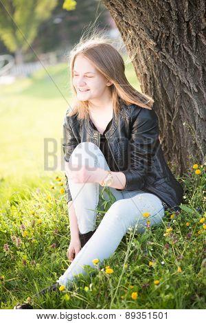 Teenage girl resting in park