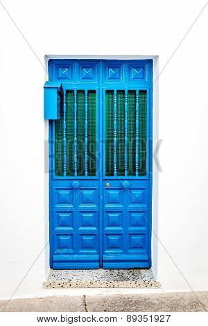 Blue Door Over White Wall. Mijas, Andalusia. Southern Spain