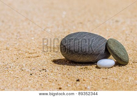 Stones In The Sand On The Beach